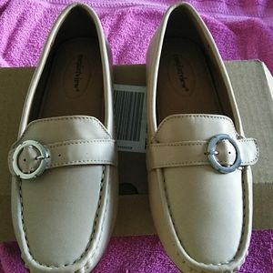 Light tan/ beige flats with a silver buckle..